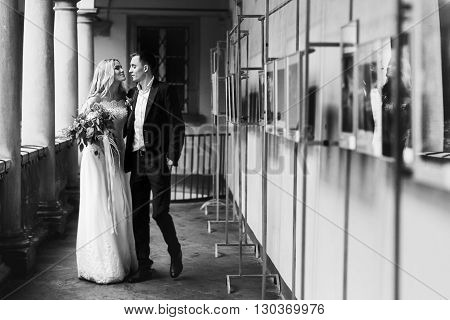 Beautiful Traveler Newlywed Couple Kissing On Italian Balcony B&w