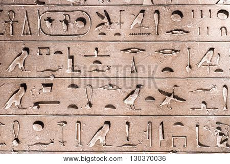 egyptian old hieroglyphs on bas relief detail close up