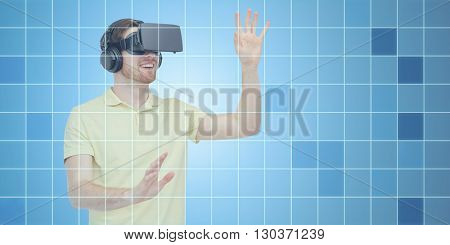 3d technology, virtual reality, entertainment and people concept - happy young man with virtual reality headset or 3d glasses playing game over blue grid background