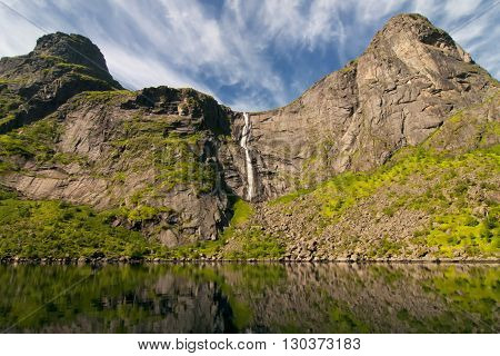 Waterfall And Mountain View In Lofoten Island Norway