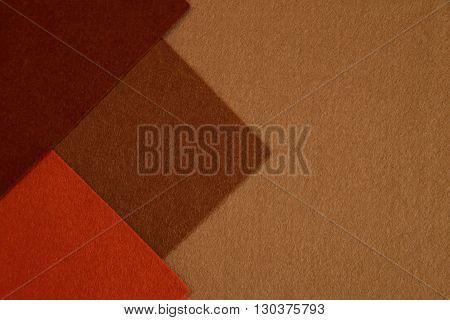 background of brown beige and orange felt texture