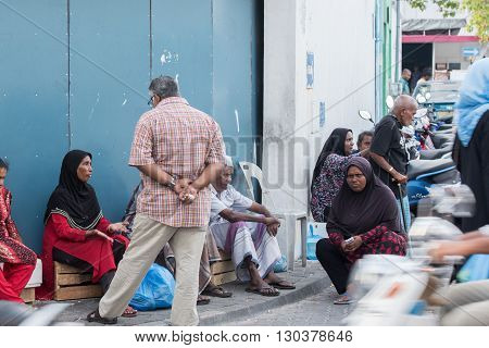 Male, Maldives - February, 13 2016 - People In The Street Before Evening Pray Time
