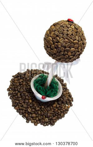 coffee tree on a white background and spilling grain