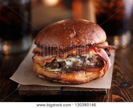 juicy bacon cheeseburger on rustic table