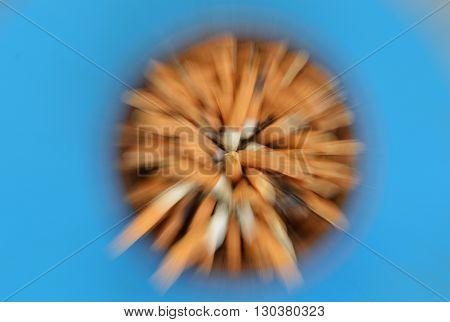 blurry zoom technique of cigarette filter in ceramic ash