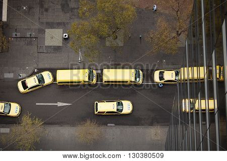 Melbourne Australia-September 13 2012. Aerial view down onto Yellow taxicabs on the streets of Melbourne Victoria Australia