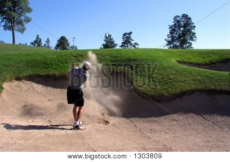 Golfer Hitting Out Of A Sand Trap (3 Of 3 Shot Action Sequence)