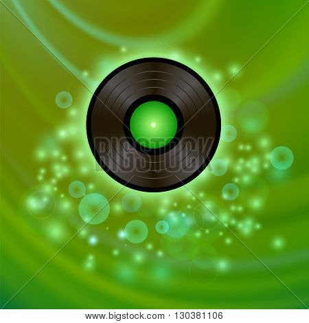 Retro Vinyl Disc on Green Blurred Background