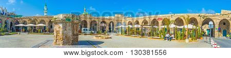 ACRE ISRAEL - FEBRUARY 20 2016: The historical complex of Khan e-Shu'arda is one of the best place in old town to relax and choose some local dishes in restaurant on February 20 in Acre.