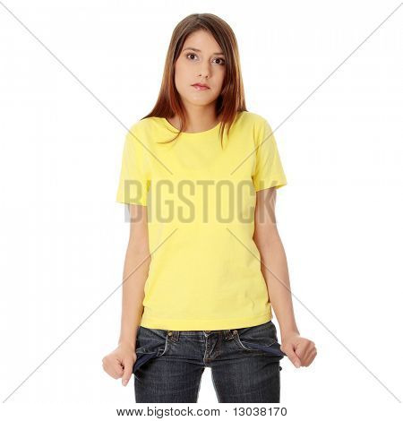 Young woman shows her empty pockets, isolated on white