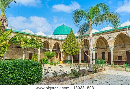 ACRE ISRAEL - FEBRUARY 20 2016: The green dome on the corner building of Al-Jazzar mosque complex on February 20 in Acre.