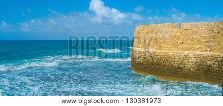 The scenic seascape with the old fortress wall Acre Israel.