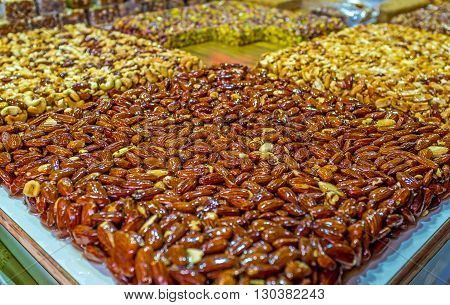 The tasty almond gozinaki - nuts in sweet caramel of honey and sugar Turkish Bazaar in Acre Israel.