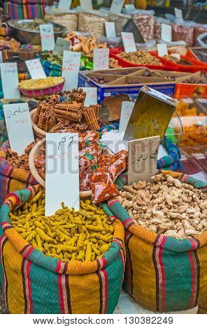 The spice stall offers ginger root cinnamon pepper and many other spices Turkish Bazaar of Acre Israel.