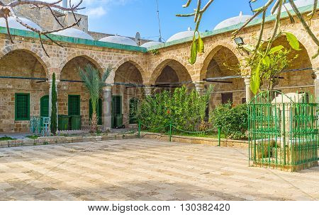 ACRE ISRAEL - FEBRUARY 20 2016: The courtyard of Al-Jazzar mosque with the students buildings of Islamic theological academy on February 20 in Acre.
