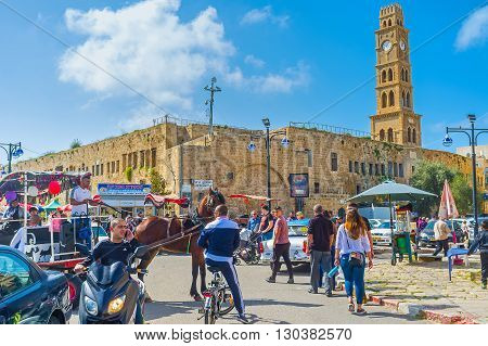 ACRE ISRAEL - FEBRUARY 20 2016: The clock tower of Khan al-Umdan (Inn of Columns) rises over the medieval Akko and is the largest and best preserved khan in Israel on February 20 in Acre.