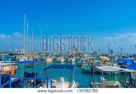 The marina of Acre with the scenic sailing yachts and small fishing boats Israel.