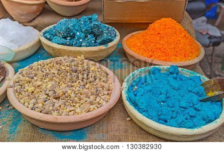 The natural herbal and mineral colorants in clay bowls in the stall of Turkish Bazaar Acre Israel.