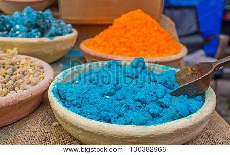 The bright blue powder in the clay bowl in Turkish Bazaar Acre Israel.