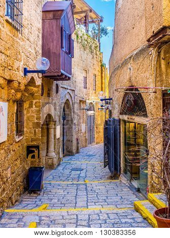 TEL AVIV ISRAEL - FEBBRUARY 25 2016: The narrow winding street of Jaffa hides the tiny stalls and interesting art galleries on February 25 in Tel Aviv.