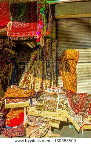 The colorful patterned silk rugs in the flea market stall of old Jaffa Tel Aviv Israel.