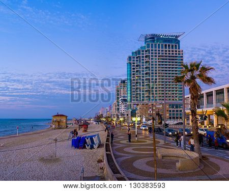 TEL AVIV ISRAEL - FEBBRUARY 25 2016: The twilight over Aviv beach and the central city promenade on February 25 in Tel Aviv.