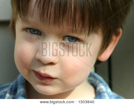 Cute Child With Blue Eyes, Close-Up, And Looking Mischievous