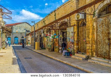 TEL AVIV ISRAEL - February 25 2016: The lamps shop in the flea market neighborhood of Jaffa offers the colorful chandeliers and lamps for each taste on February 25 in Tel Aviv.