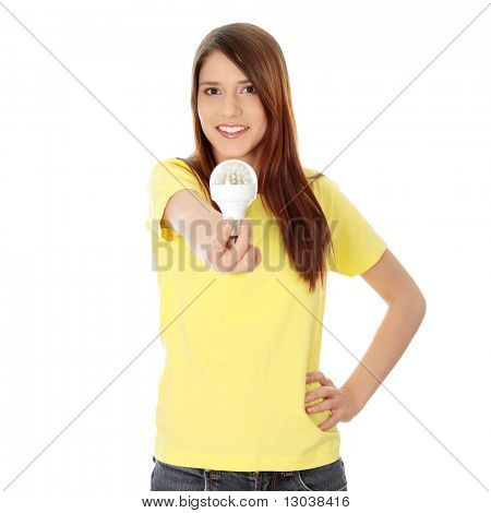 Young happy woman holding diode bulb, isolated on white