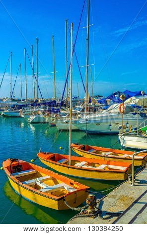 The beautiful orange boats in old Jaffa port Tel Aviv Israel.