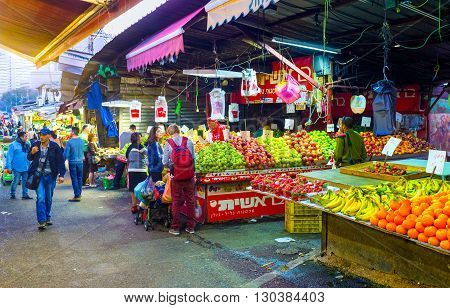 TEL AVIV ISRAEL - FEBBRUARY 25 2016: The different fruits in Carmel market stall attract the clients on February 25 in Tel Aviv.