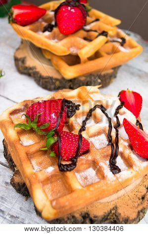 Belgium waffles with strawberries and chocolate. Top view