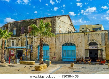 TEL AVIV ISRAEL - February 25 2016: The port town of Jaffa is famous among the tourists for its scenic cityscapes tasty cousine and unique flea markets on February 25 in Tel Aviv.