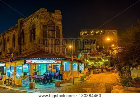 TEL AVIV ISRAEL - FEBBRUARY 25 2016: The cafe in the old Jaffa in the evening lights on February 25 in Tel Aviv.