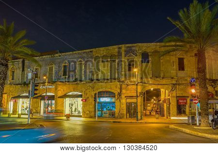 TEL AVIV ISRAEL - FEBBRUARY 25 2016: The brightly illuminated streets of old Jaffa are the best place for the evening walks on February 25 in Tel Aviv.