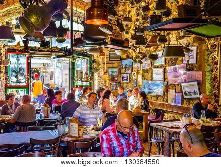 TEL AVIV ISRAEL - FEBRUARY 25 2016: The old Jaffa is famous for its unusual and interesting taverns with tasty dishes on February 25 in Tel Aviv.