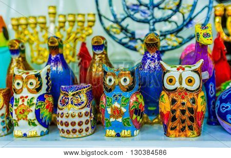 The colorful owls and other birds decorated with floral patterns in the souvenir shop of Jaffa Tel Aviv Israel.