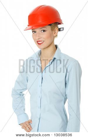Portrait of confident female worker in red helmet