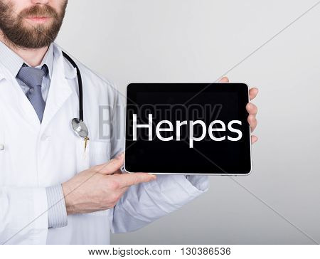 technology, internet and networking in medicine concept - Doctor holding a tablet pc with herpes sign. Internet technologies in medicine.
