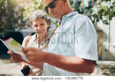 Couple Of Tourist Reading The City Map
