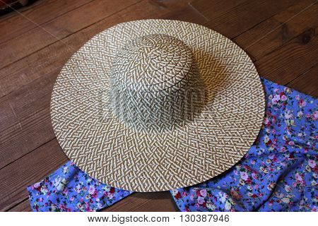 summer women's clothing and accessories on the wooden background
