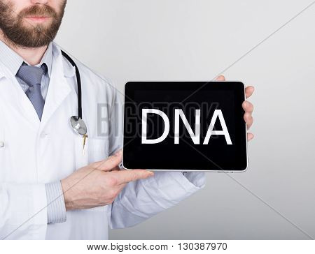 technology, internet and networking in medicine concept - Doctor holding a tablet pc with dna sign. Internet technologies in medicine.