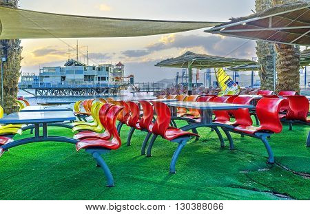 EILAT ISRAEL - FEBRUARY 23 2016: The scenic outdoor cafe located in beach zone next to the yacht club on February 23 in Eilat.