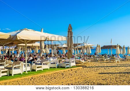 EILAT ISRAEL - FEBRUARY 23 2016: The central beach with the shady summer terrace of the restaurant and lounge bar on February 23 in Eilat.