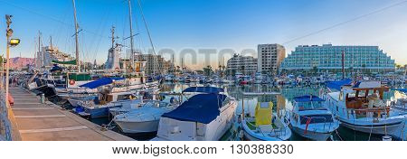 The evening marina is especially beautiful all the ships and yachts are bobbing on the waves Eilat Israel.