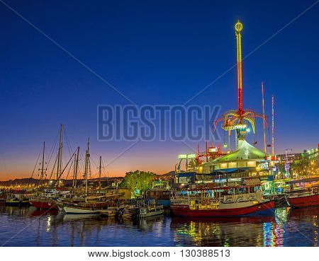 EILAT ISRAEL - FEBRUARY 24 2016: The amusement park becomes one of the brightest noisiest and colorful places in the evening on February 24 in Eilat.
