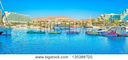 EILAT ISRAEL - FEBRUARY 23 2016: Panorama of marina with a lot of tiny colorfull tourist boats on February 23 in Eilat.