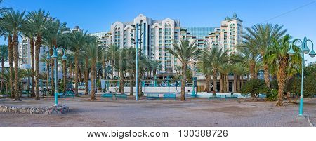 The tourist districts of resort consists of the modern comfortable hotels surrounded by gardens restaurants stores and lounge zones Eilat Israel.