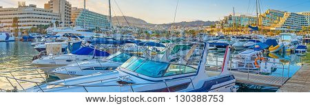 EILAT ISRAEL - FEBRUARY 23 2016: The moored motor boats slowly bob on the waves in Lagoona on February 23 in Eilat.