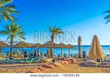 EILAT ISRAEL - FEBRUARY 23 2016: The best way to relax in Eilat is to visit local beach and to swim on February 23 in Eilat.